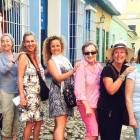 An image of a group of friends on a tour of Cuba