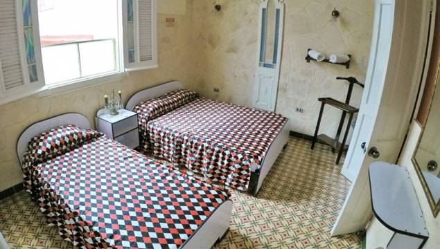 An image of a simple guesthouse room in Havana, Cuba.