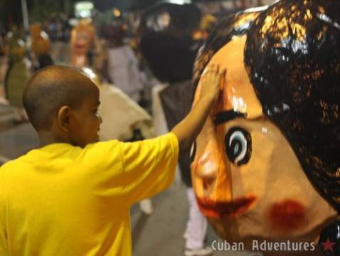 Big head doll with child in Santiago de Cuba's Carnival