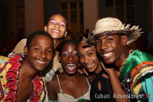 Children with dancers in Santiago de Cuba's Carnival